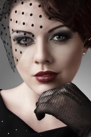 Beautiful young woman retro style studio portrait