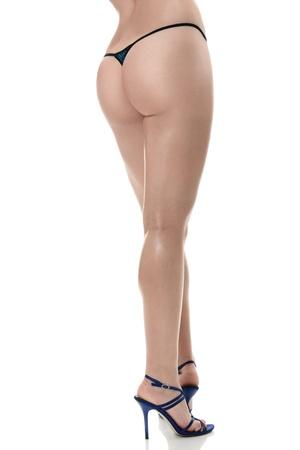 culo: Belle sexy gambe lunghe femminile isolato su sfondo bianco