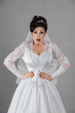 Young bride in a very tight corset photo