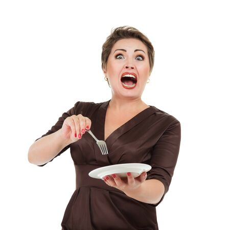 emotional woman: Emotional screaming woman with dish and fork in hands Stock Photo