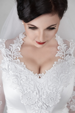 Young beautiful bride in wedding dress and luxury coiffure photo