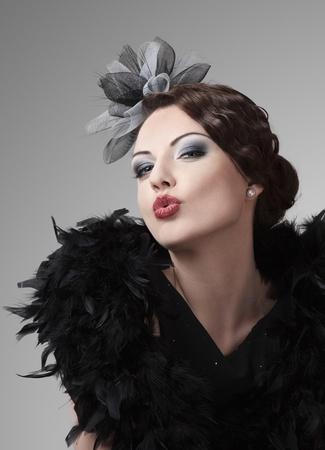 blow kiss: Retro style fashion model making a kiss Stock Photo