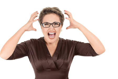 angry face: Aggressive screaming businesswoman isolated on white background Stock Photo
