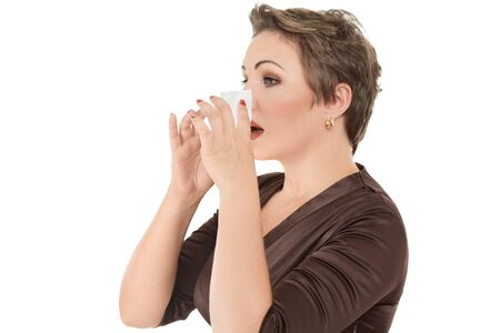 Woman with cold or flu sneezing into tissue over white background photo
