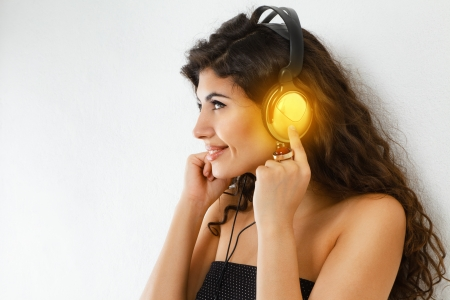 sexy headphones: Young smiling woman with headphone listening to music Stock Photo