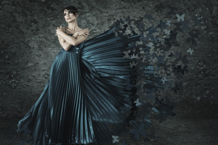 Young fairy woman in long dress made from butterflies flying out under wind Stock Photo - 15290923