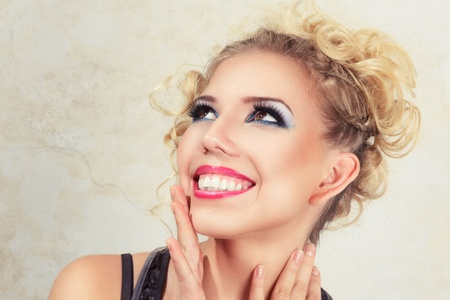 woman open mouth: Beautiful happy surprised blonde young woman studio portrait
