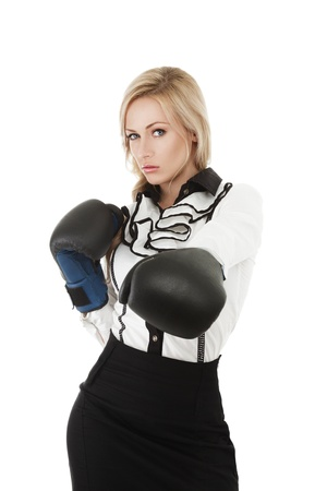Aggressive business woman in boxing mitten isolated on white background photo