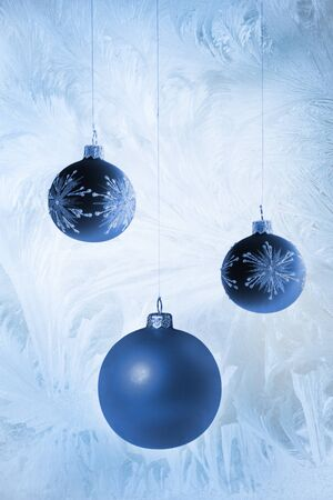 Shiny christmas baubles on blue frost background Stock Photo - 16803526