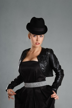 Blonde young woman in black leather jacket and hat Stock Photo - 17591787