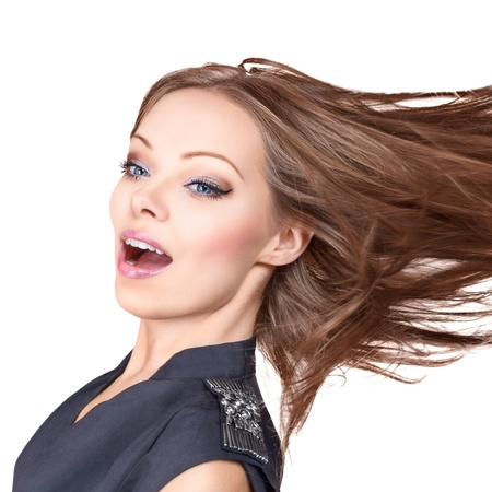 messy hair: Young beautiful woman posing in studio isolated on white background Stock Photo