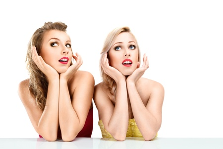 Portrait of two young beautiful blonde women isolated on white background
