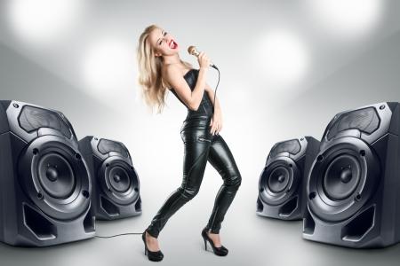 karaoke singer: Karaoke singer at night in black leather clothing