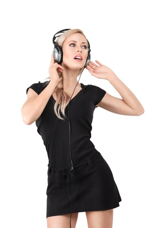 Young blonde woman with headphones listening to music photo