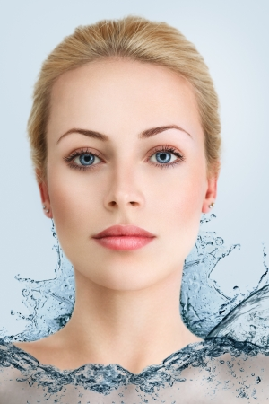 Young beautiful blonde woman in water dress photo