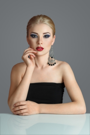 hairdo: Attractive young blonde woman with ornate earring