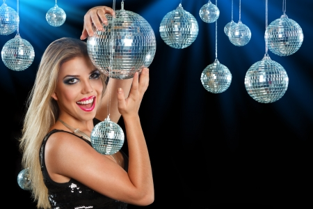 Young blonde woman dancing at night disco club Stock Photo - 19339723