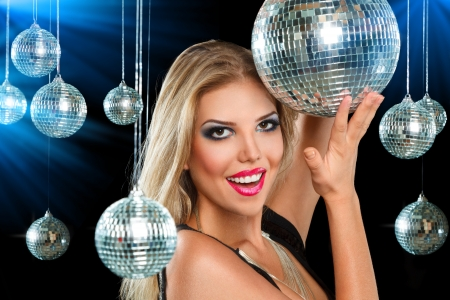 Young blonde woman dancing at night disco club Stock Photo - 19339727