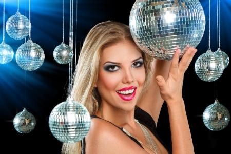 woman dancing: Young blonde woman dancing at night disco club