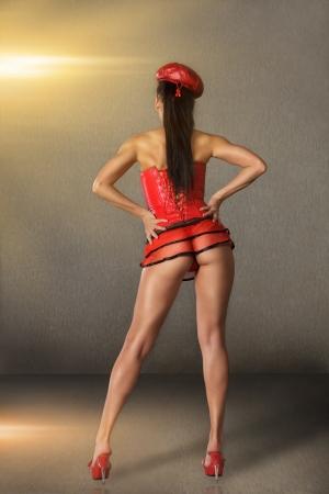 high performance: Modern style go-go dancer posing on studio. rear view Stock Photo