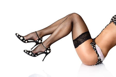 pantimedias: Hermosas piernas femeninas largas aisladas sobre fondo blanco Foto de archivo