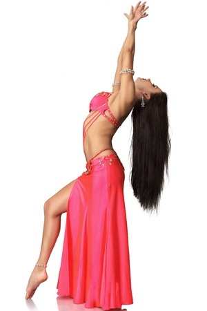 Beautiful exotic belly dancer young attractive woman isolated on white background photo