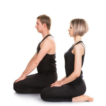 two minds: Man and woman doing yoga. Isolated on white background
