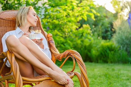 recliner: Young blonde woman wearing in man Stock Photo