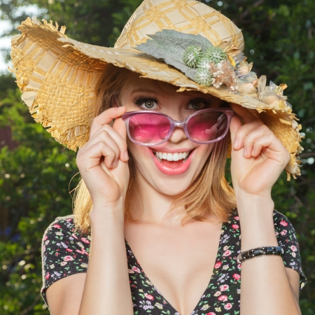 Happy young woman in sun hat outdoor portrait photo
