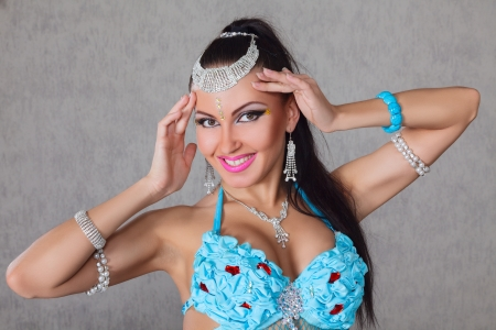 Beautiful exotic belly dancer young attractive woman photo