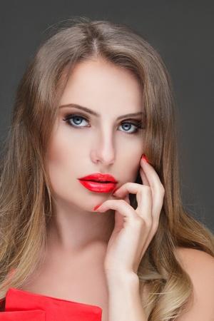 Beautiful young woman touching face. Studio portrait Stock Photo - 20668177