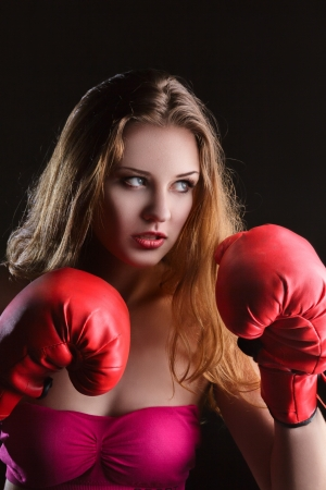 Young blonde woman with boxing gloves isolated on white background photo