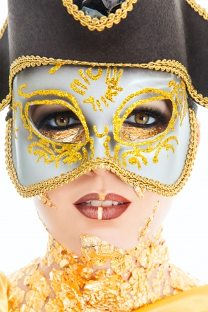 Young woman face with gold make-up and carnival mask isolated on white background Stock Photo