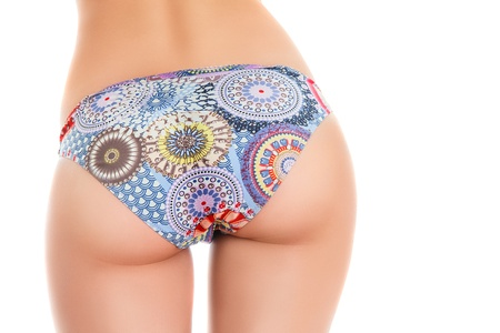 Perfect buttocks close-up studio photo isolated on white background