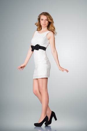 Beautiful young slim woman full body studio portrait