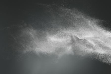 dark cloud: Abstract design of white powder cloud against dark background