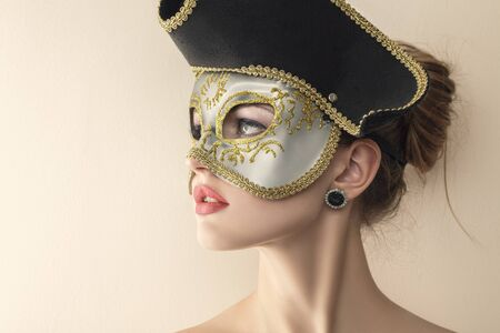 Beautiful young woman in mysterious venetian carnival mask.  photo