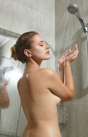 bathtub: Beautiful young woman taking shower and relaxing