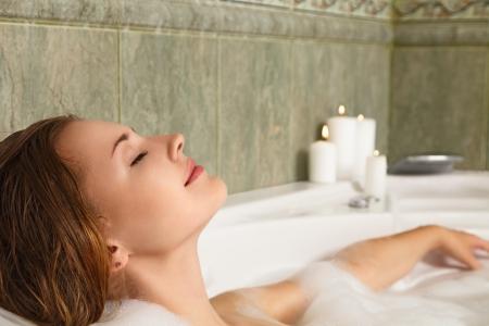 bath: Young beautiful woman relaxing in a bath Stock Photo