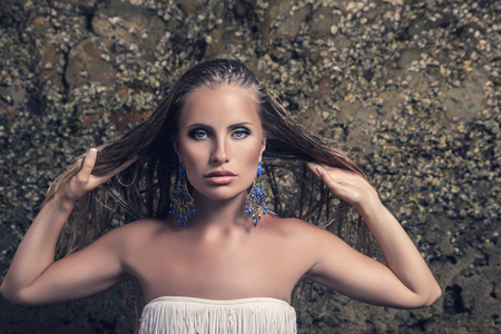 ornated: Young fashion model with blue ornated earrings  Stock Photo