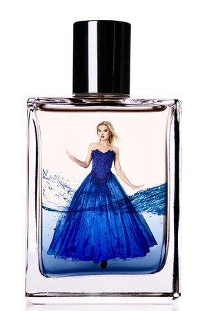 beautiful model: Fashion model in a long luxurious dress inside a perfume flask
