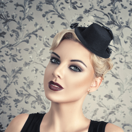 Retro style fashion woman with smoky make-up and vintage hat photo
