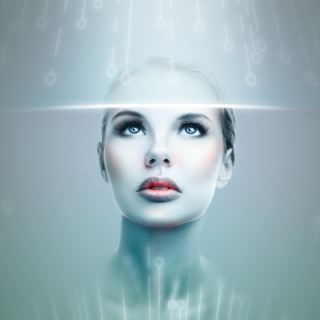 futuristic woman: Abstract futuristic woman looking at data flow in a virtual display Stock Photo