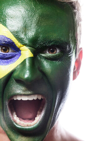 soccer fan: Soccer fan with brazil flag painted over face Stock Photo