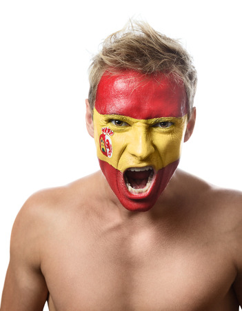 Soccer fan with spain flag painted over face photo