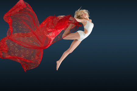 flying woman: Woman dancing with a strips of fabric over gray background Stock Photo