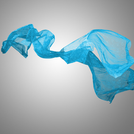 veil: Abstract blue flying motion fabric over gray background Stock Photo