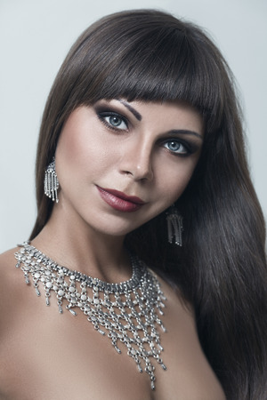 Young woman posing with Indian style necklace and earrings photo