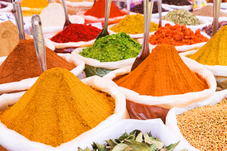 curry powder: Indian spices in bags at traditional street market Stock Photo