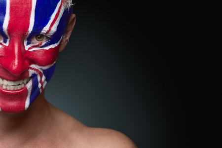 britain flag: Soccer fan with great britain flag painted over face Stock Photo